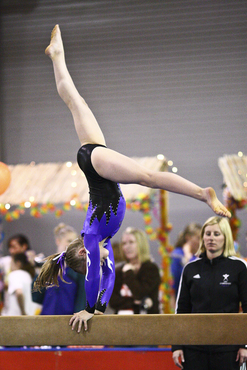 Back Walkover on Beam at a Level 6 Gymnastics Competition (2/4)