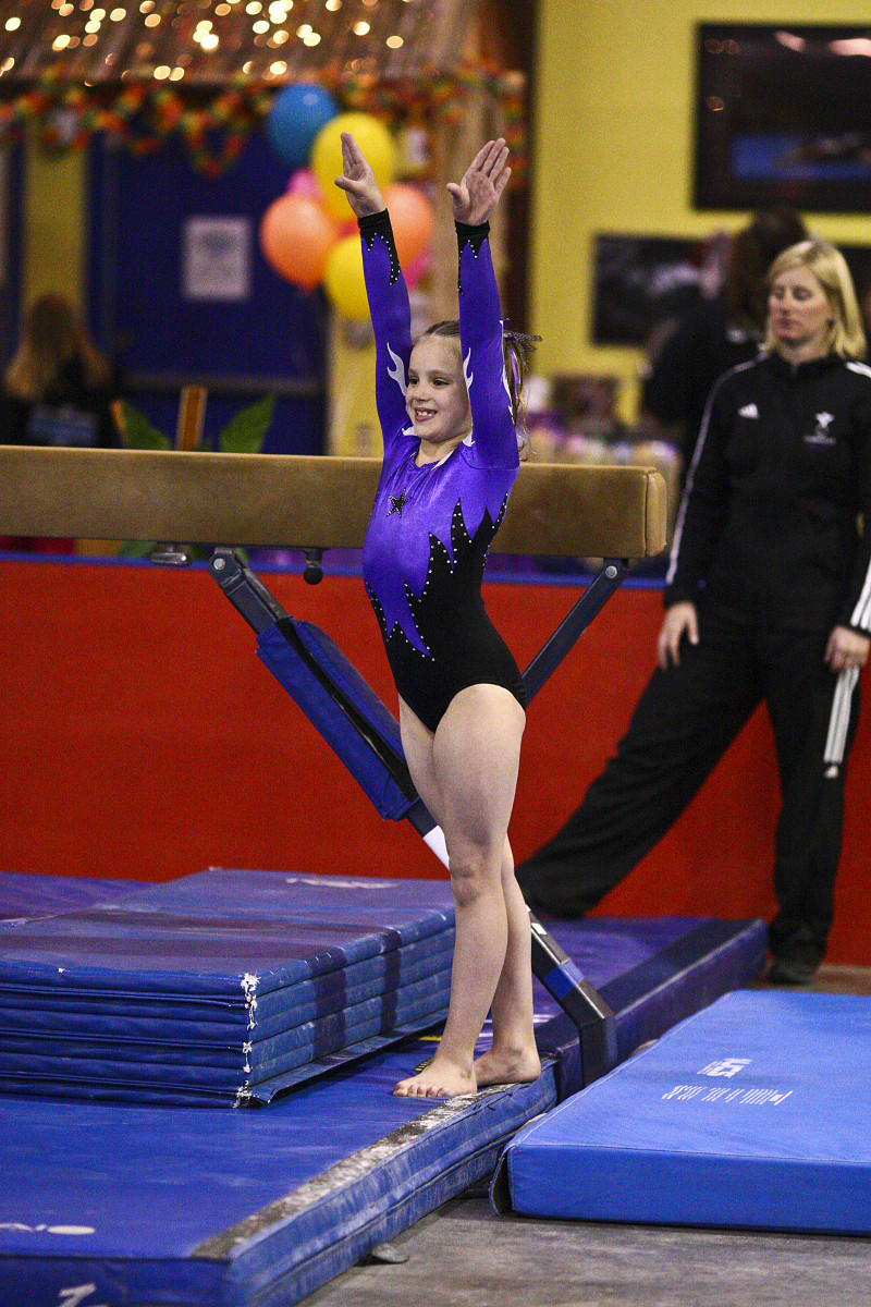 Back Walkover on Beam at a Level 6 Gymnastics Competition (4/4)
