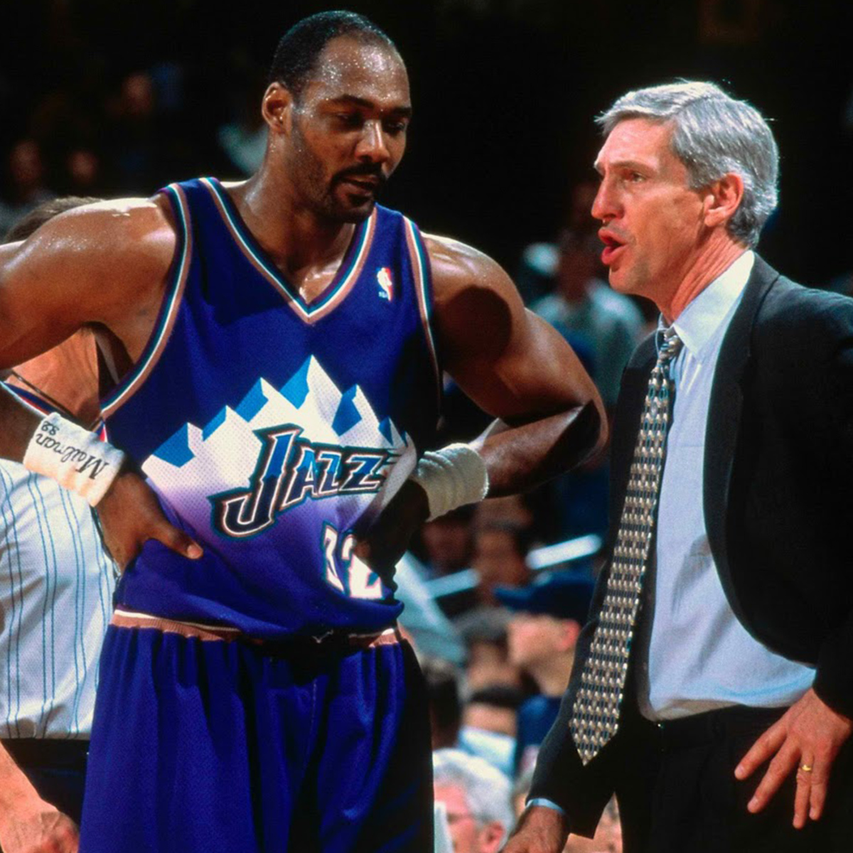 Karl Malone discussing matters with Utah Jazz coach.