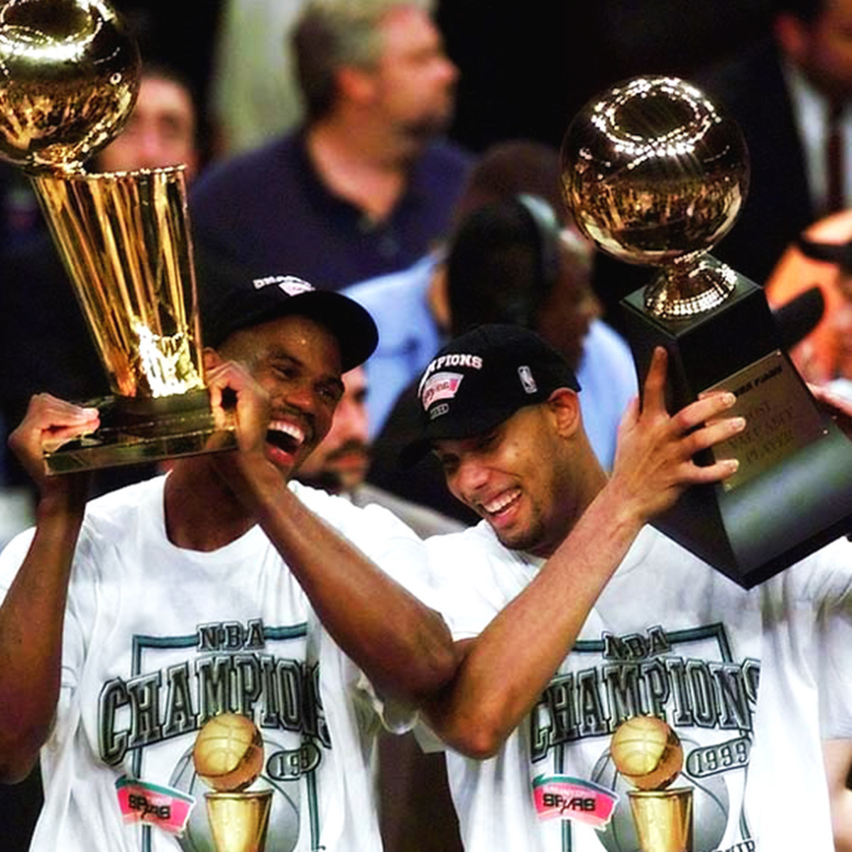 David Robinson with teammate Tim Duncan winning NBA championship.