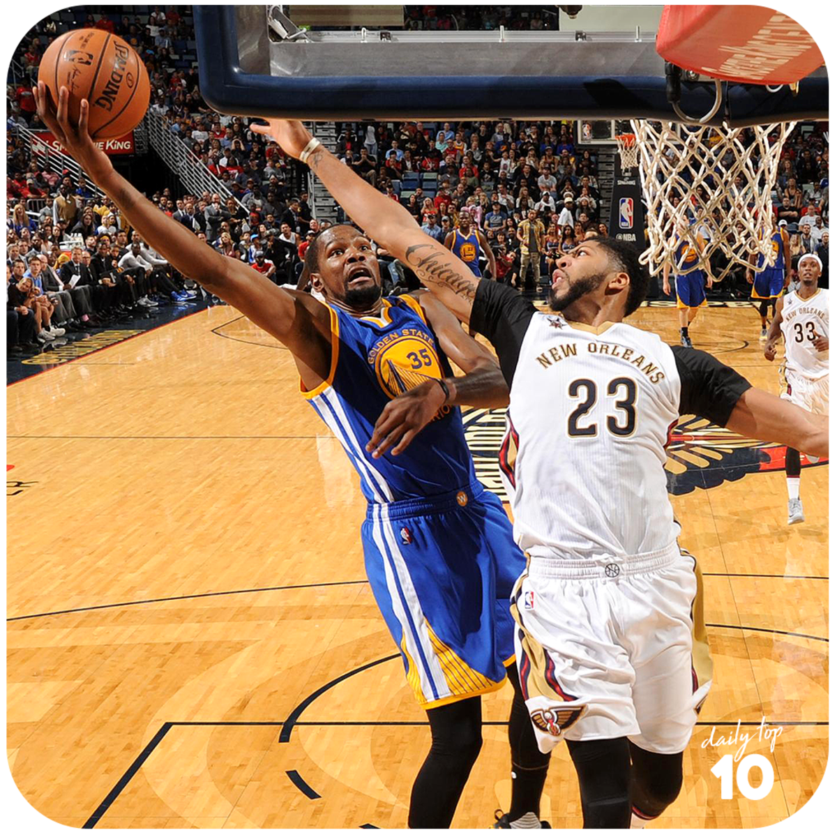 Kevin Durant making a lay up against Anthony Davis of the New Orleans Pelicans.