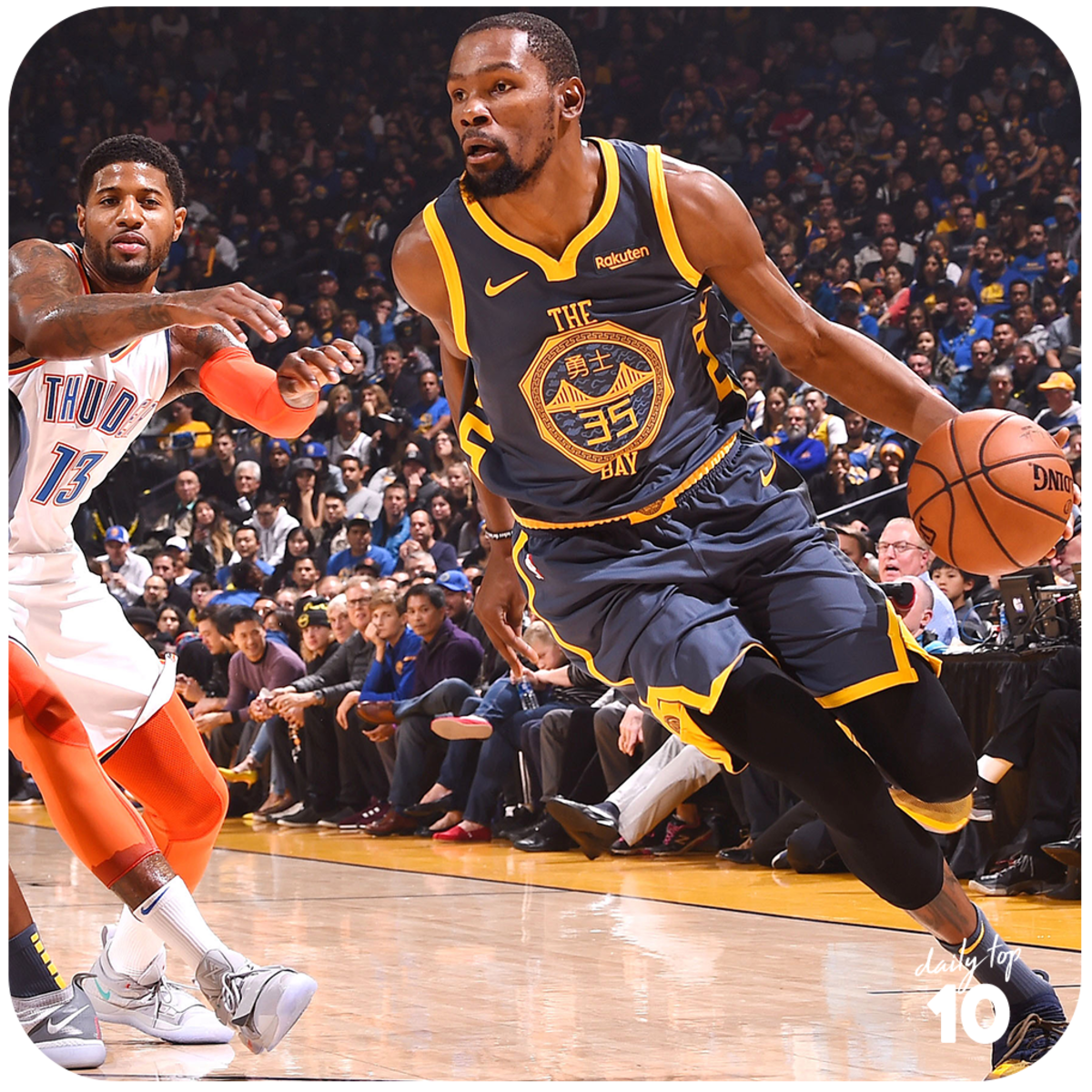 Kevin Durant drives while being chased by Paul George of the Oklahoma City Thunder.
