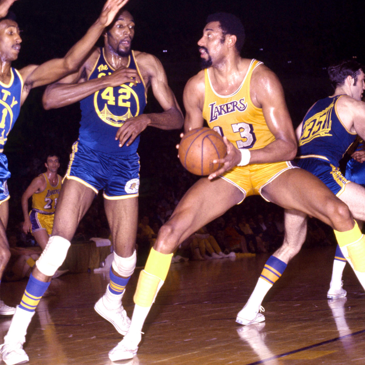 Wilt Chamberlain against multiple defenders.