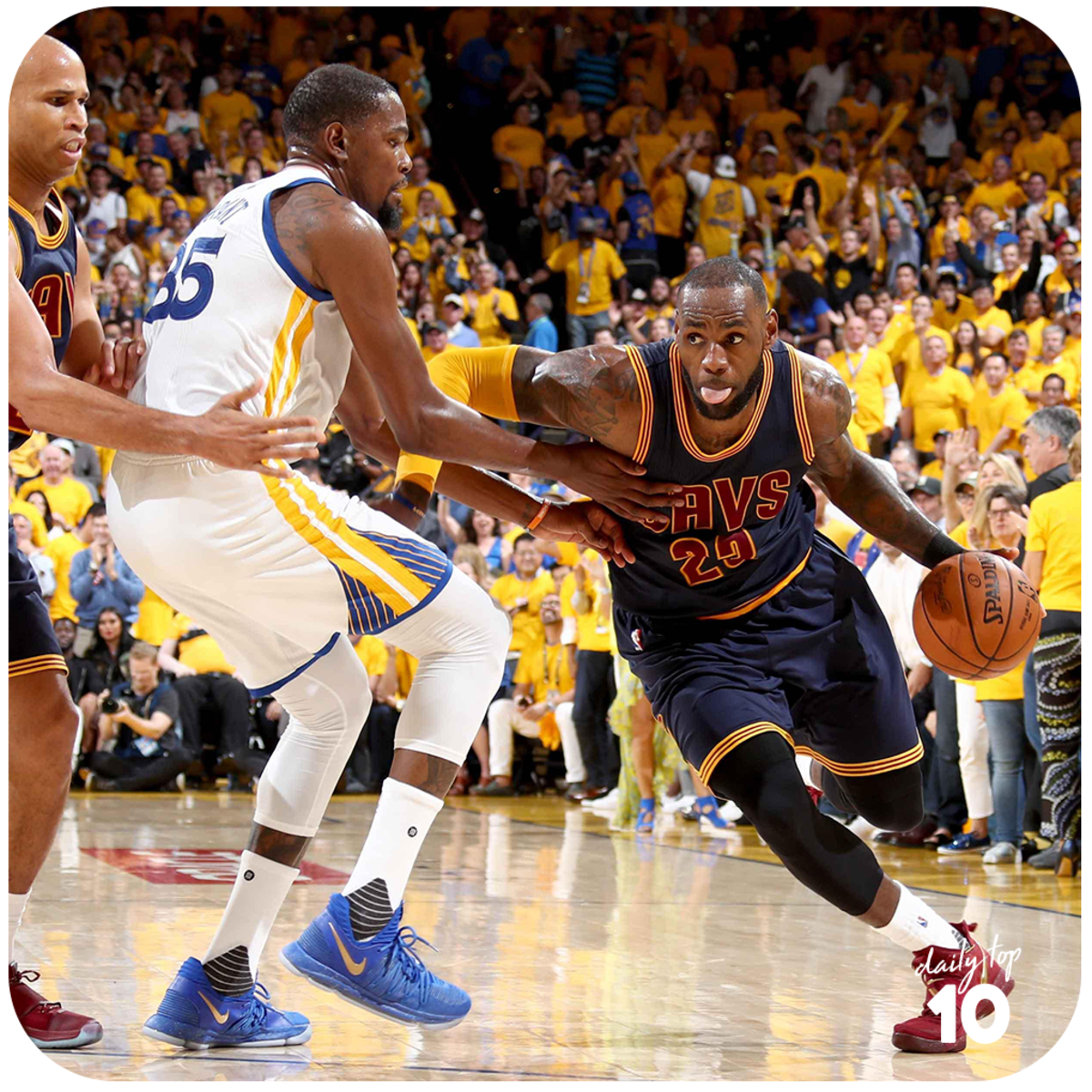 Lebron James drives to the hoop while Kevin Durant defends.