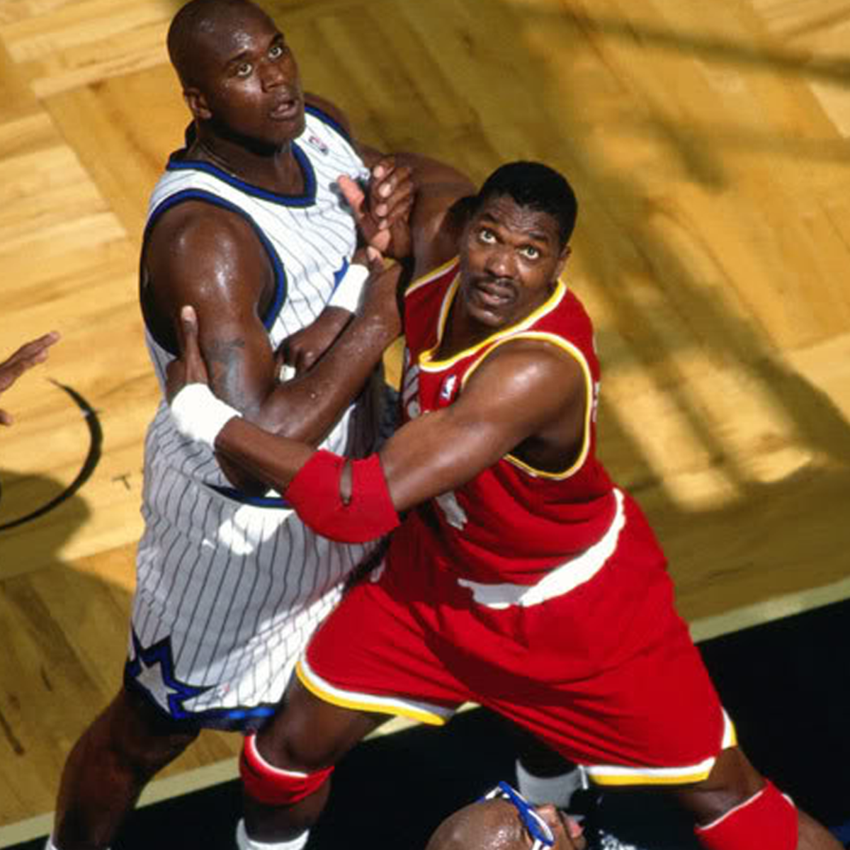 Hakeem Olajuwon fighting for the rebound.