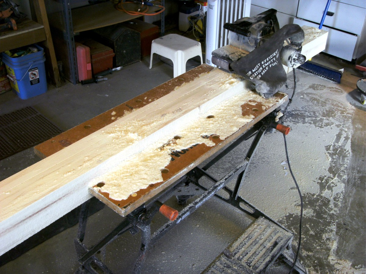 A good deal of material had to be removed with the belt sander to even up the surface.  After this first rough sanding, additional work was done with an orbital sander and progressively finer grits of sandpaper.