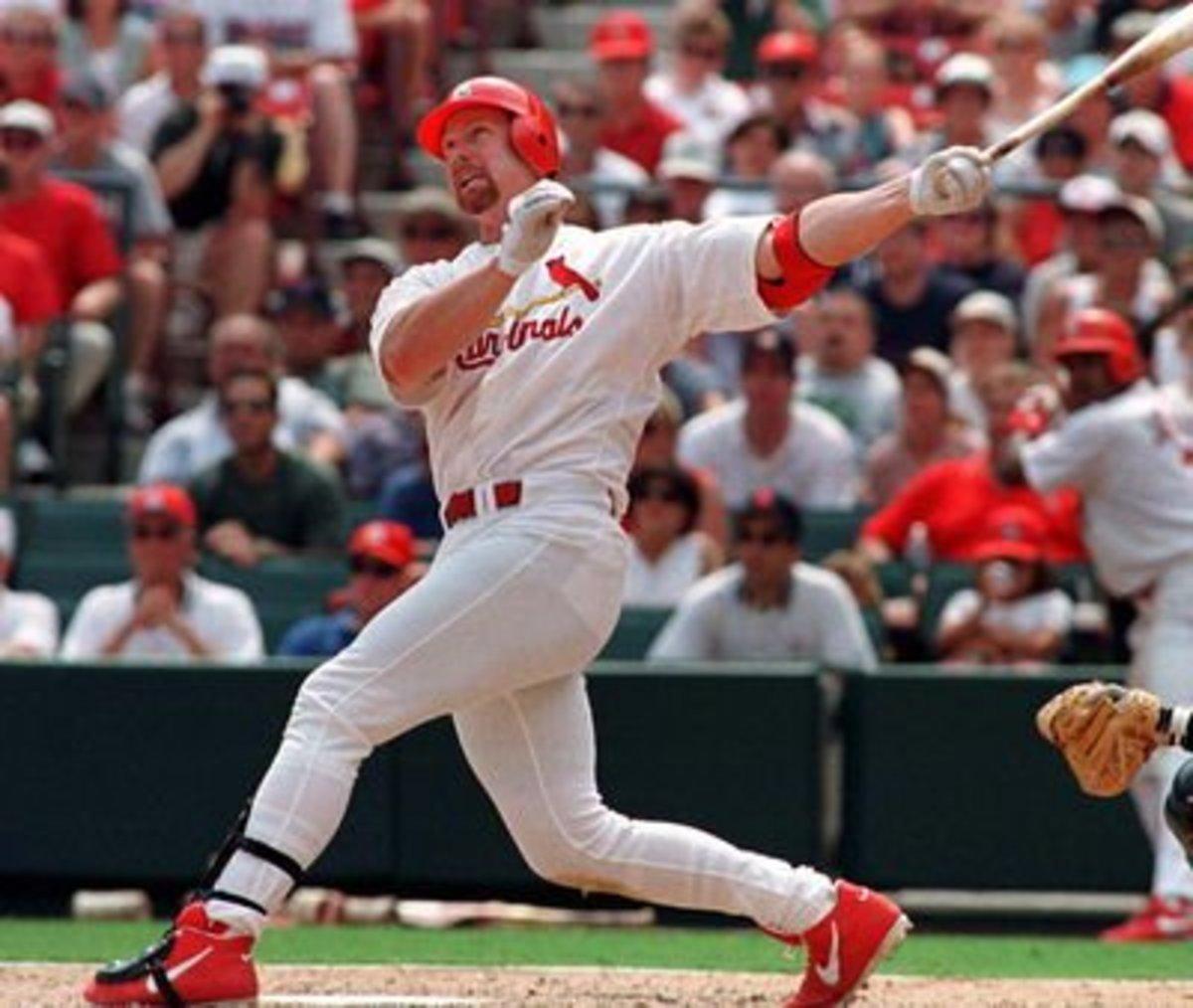 Mark McGwire had 4 consecutive seasons of hitting at least 50 home runs.