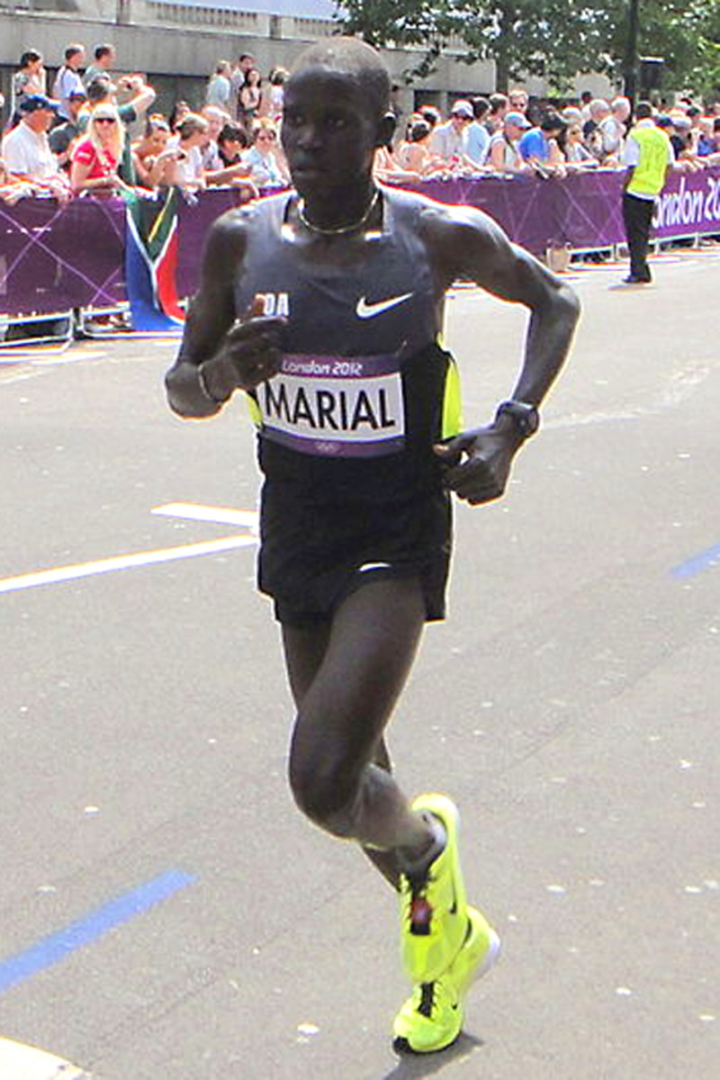 Guor Marial  of South Sudan. This new nation did not have an Olympic committee, so Guor had to compete in the marathon under the auspices of the Olympic flag.