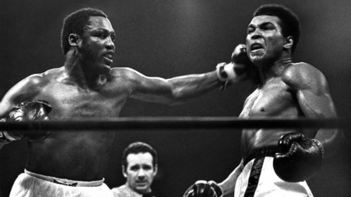 Frazier nails Ali with left hook