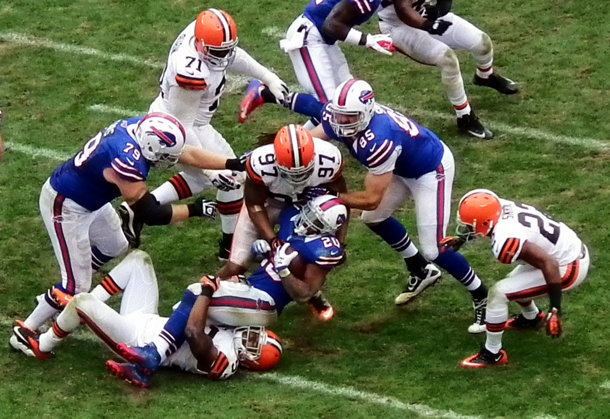 A defensive tackle stopping the offense.