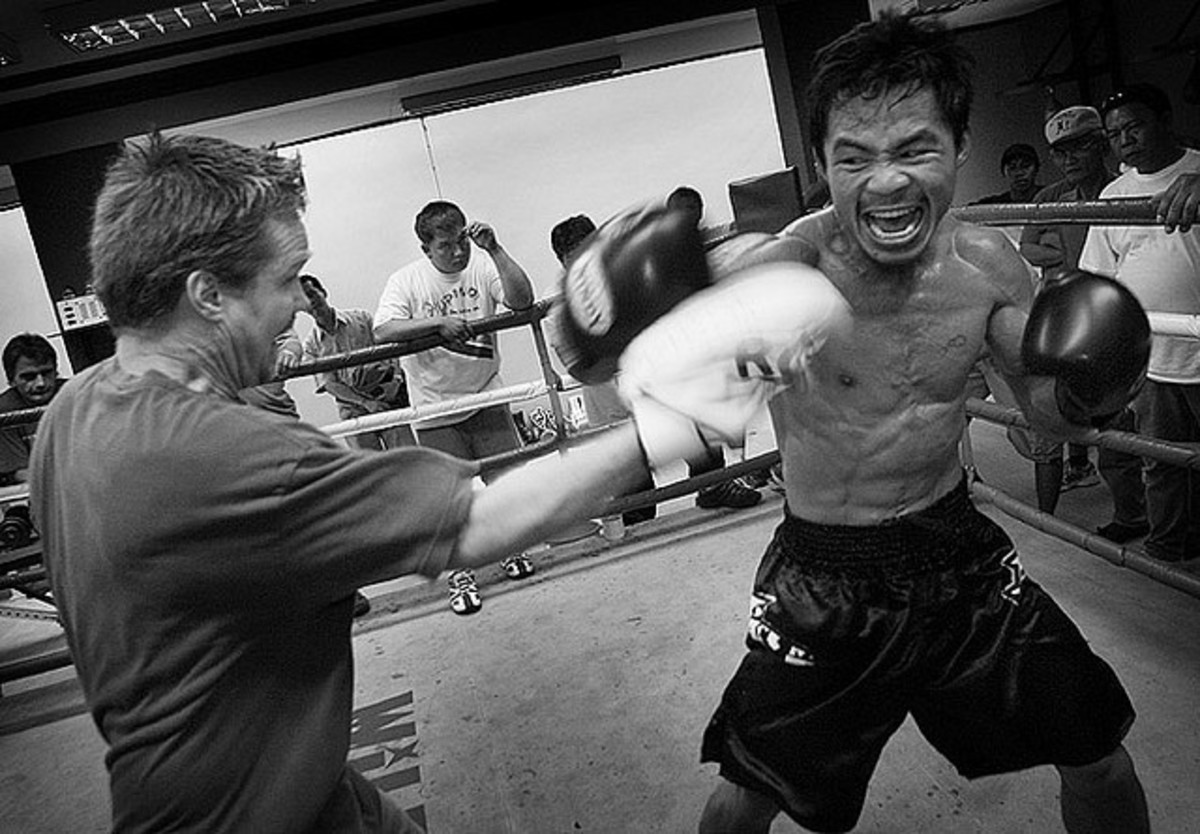 "Manny ""Pac Man"" Pacquiao, famous champion boxer, delivering one of his notoriously powerful punches."