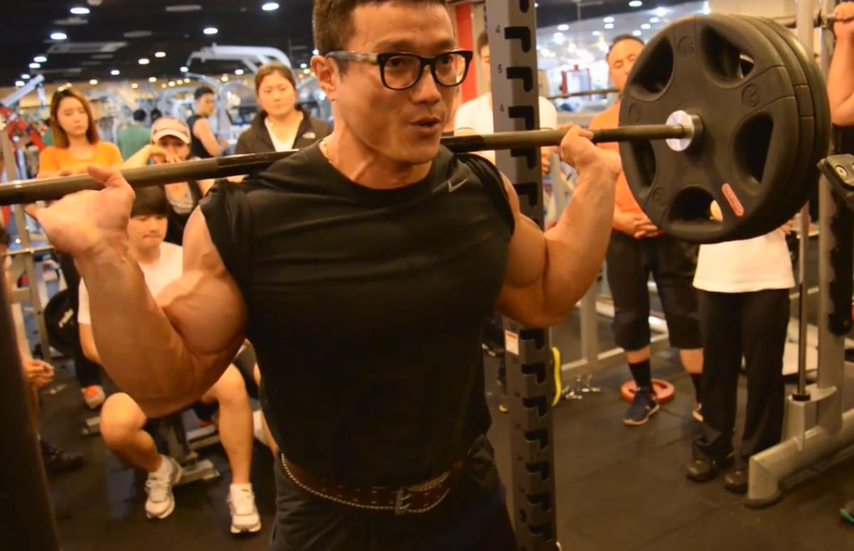 Kang demonstrating squat technique