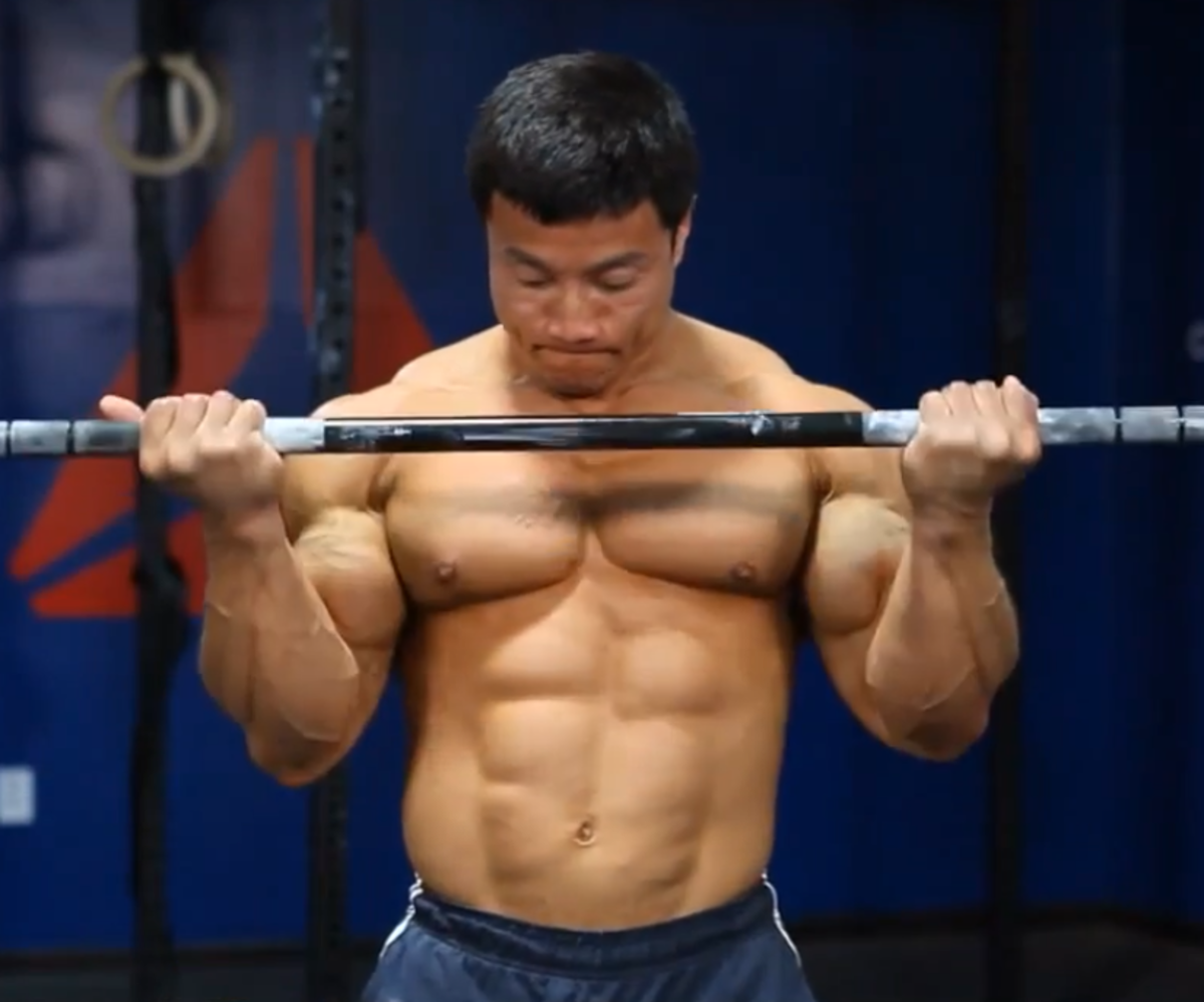 Kang doing barbell bicep curls