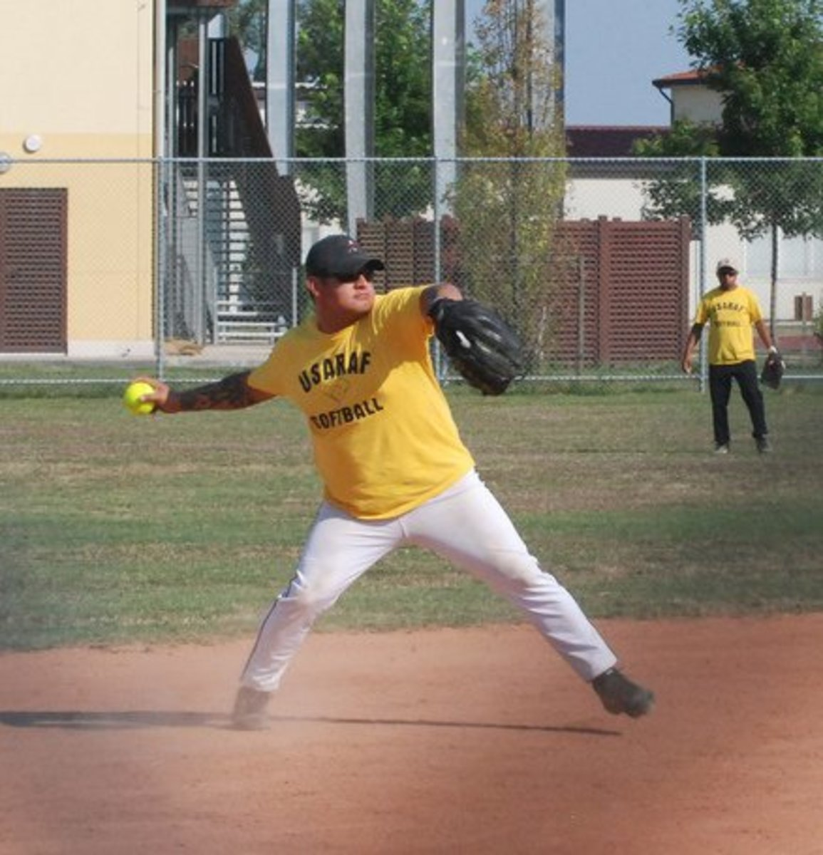 Note how the man has stepped forward with his opposite foot and is beginning to move his hips to the front, drawing his throwing arm across his body horizontally; a professional throwing technique.