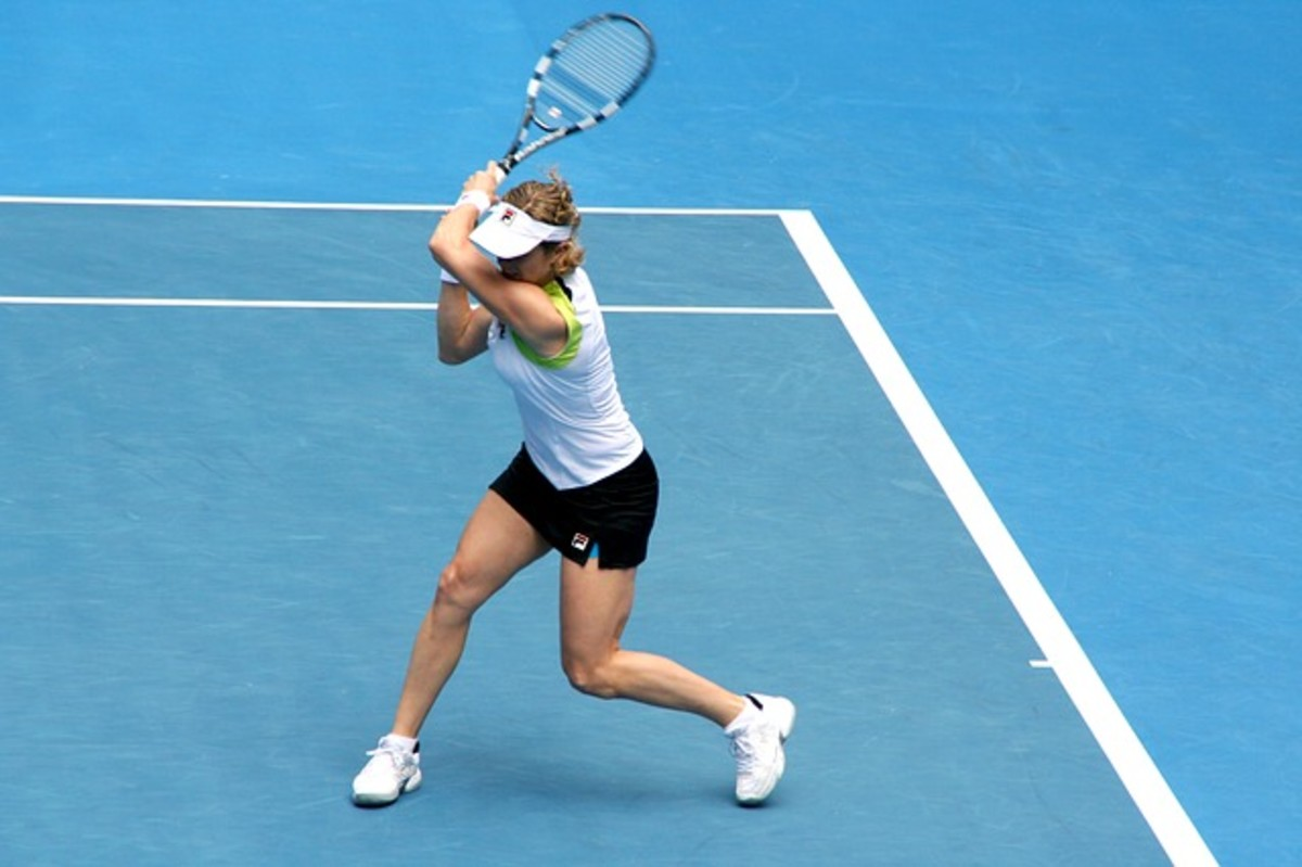 Kim Clijsters playing at the Australian Open in 2012.  Now retired from Professional Tennis, the Belgian player is a former world No. 1 in both singles and doubles.  With her powerful physique and strong baseline game, Clijsters remains a tennis icon