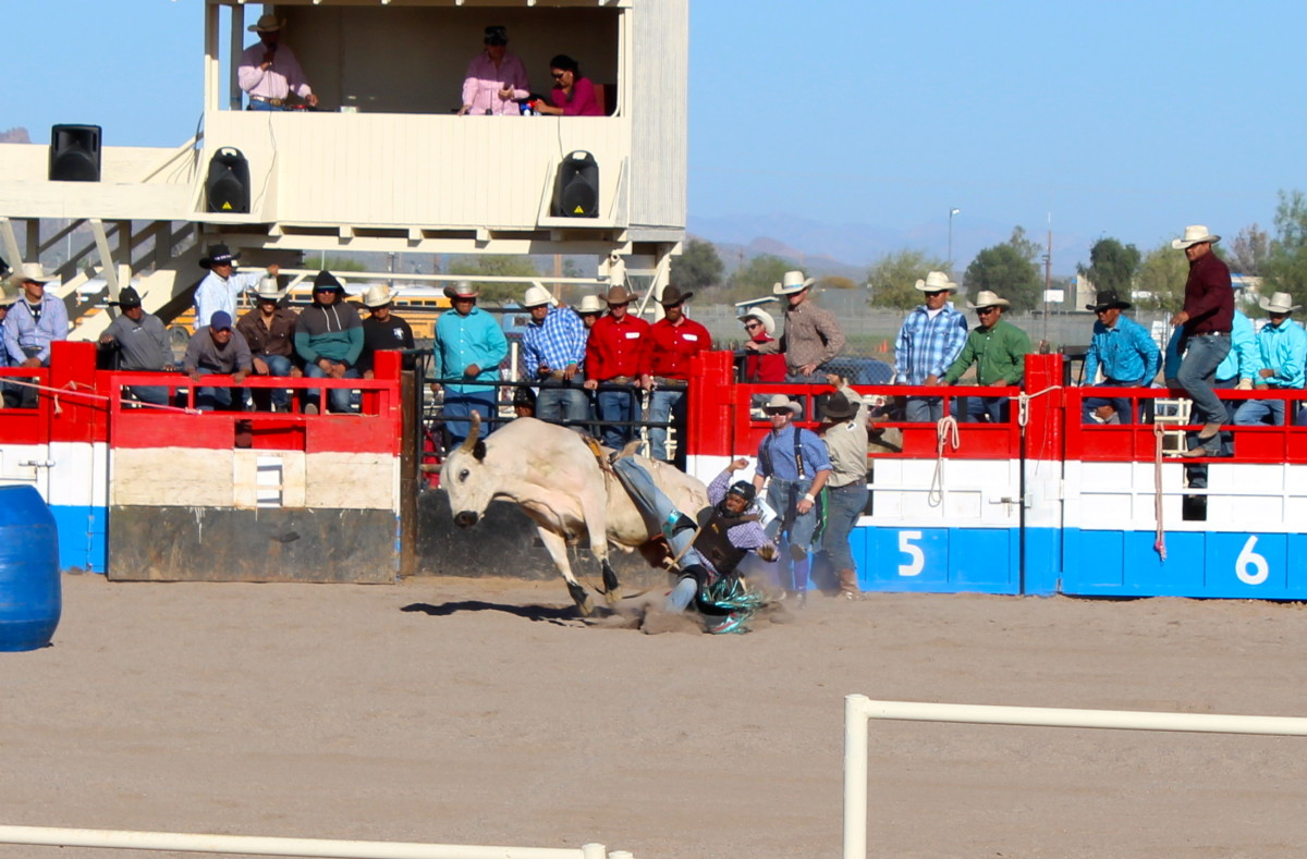 A bull rider parts ways with his mount.