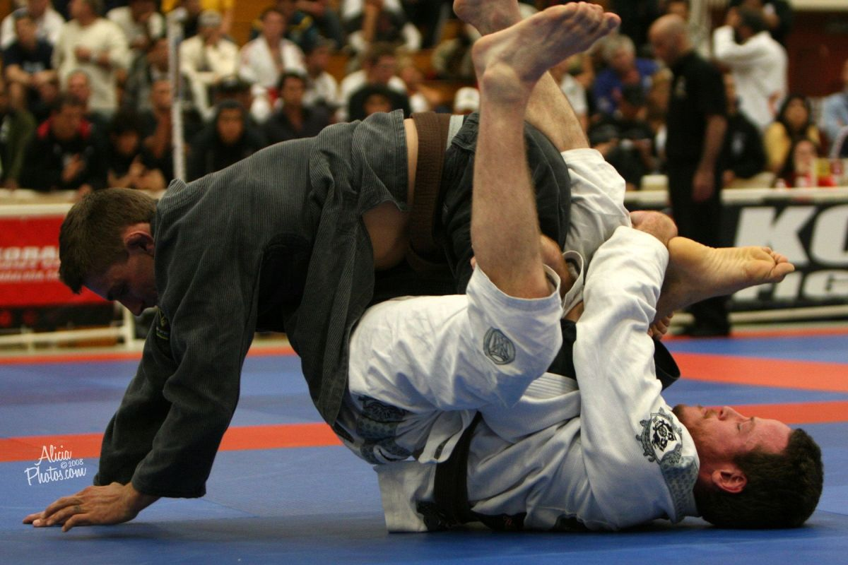 Me using a kneebar from the bottom of half guard in the Pan Ams masters brown belt division in 2008.  Photo by Alicia Anthony.