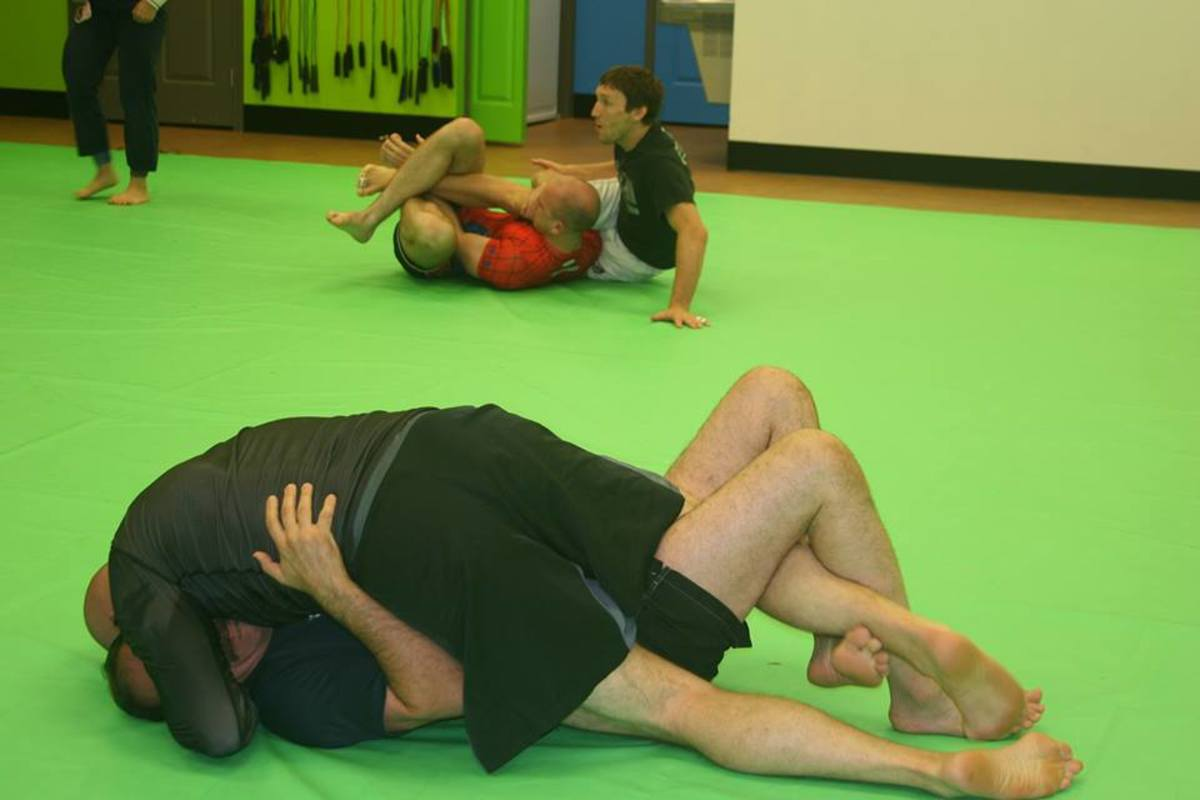 Students trying to work deep half (background) at Revolution BJJ.