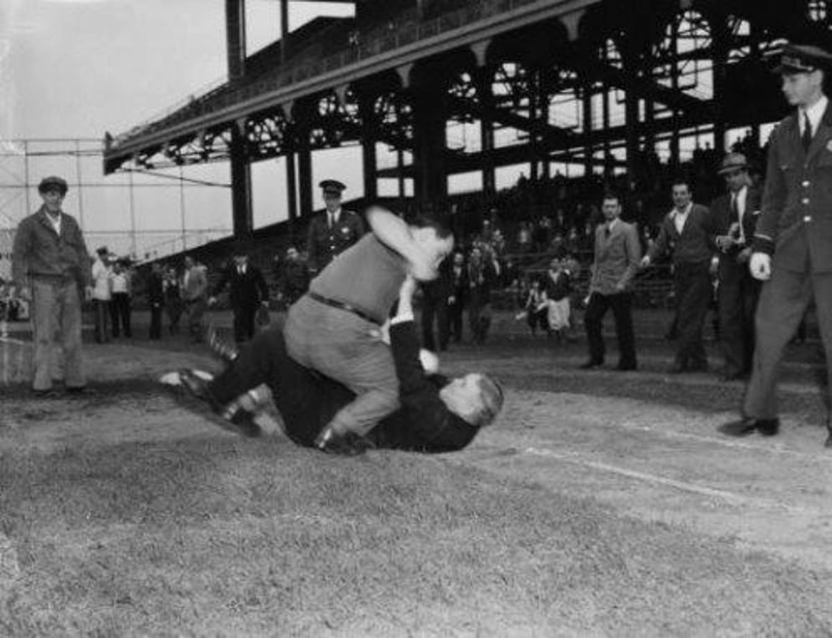Were people really better behaved years ago? Ebbets Field 1940. An angry Dodger fan attacks an umpire after a bitter extra inning loss to the Cincinnati Reds.  This guy would be charged with terrorism today.