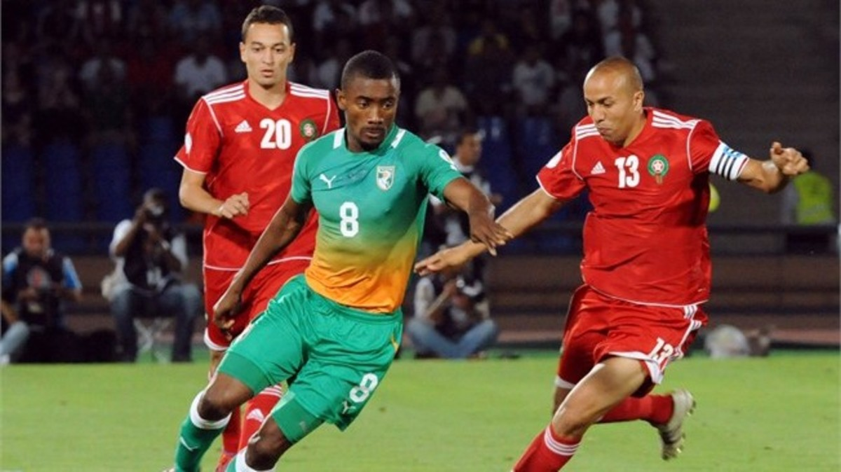 Ivory Coast's Salomon Kalou (8) in action as he fights for possession with Houssine Kharja (13) of Morocco during a World Cup qualifier in Marrakech, Morocco on June 9, 2012.