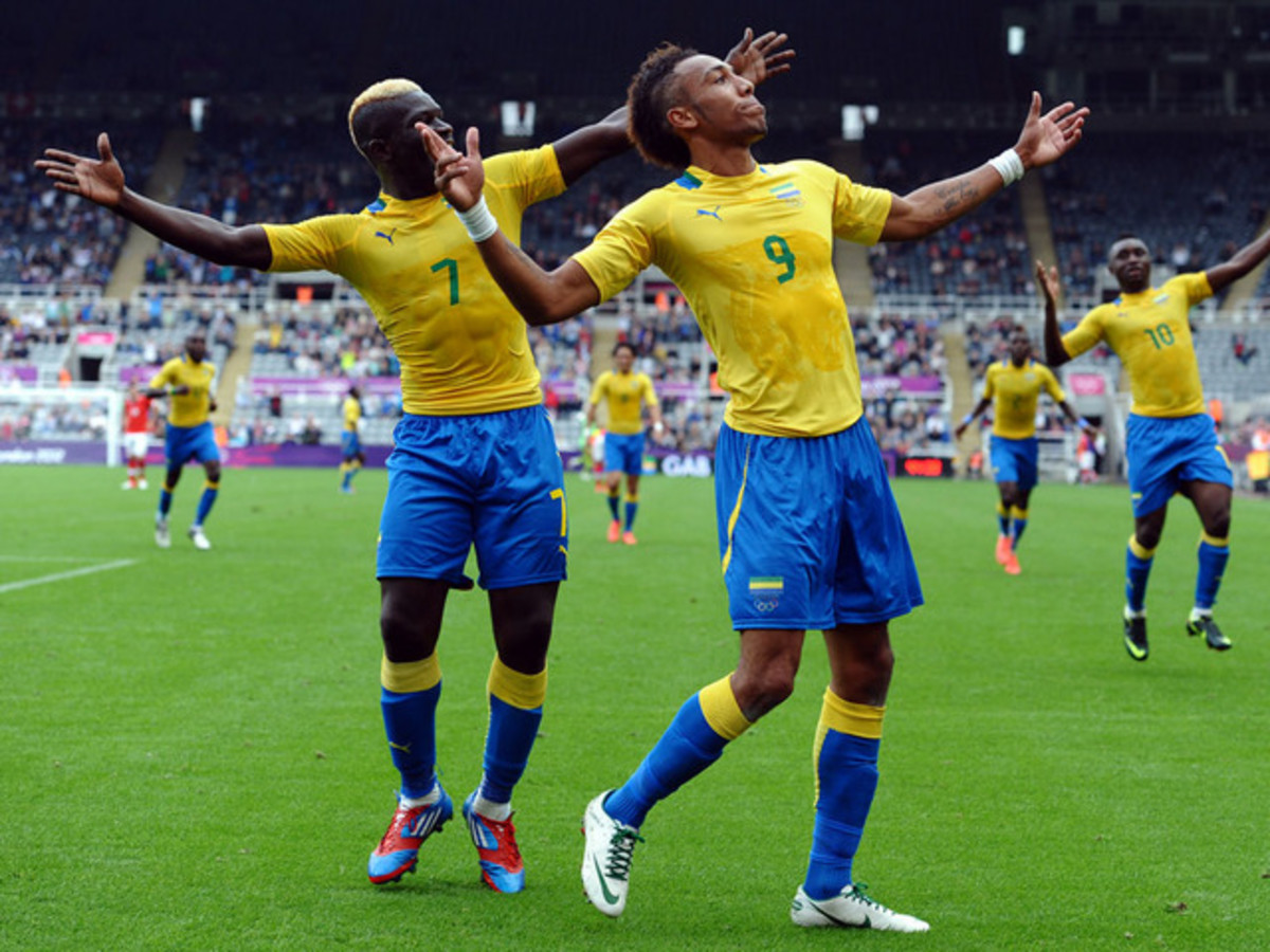 Pierre-Emerick Aubameyang (9) celebrates with Allen Nono (7) after scoring against Switzerland during the 2012 Olympic tournament. Aubameyang had earlier guided Gabon to a quarter-final berth at the 2012 AFCON.