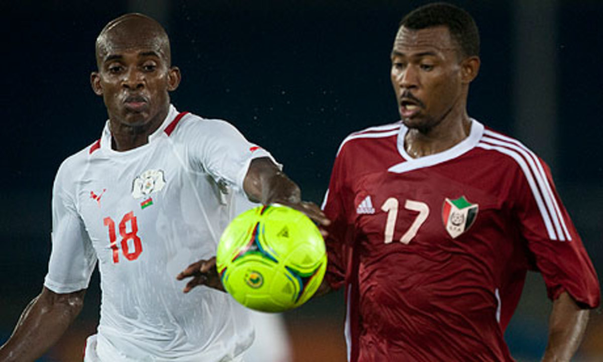 Sudan's Mudather El Tahir (17) battles for possession with Burkina Faso's Charles Kabore in a 2012 AFCON group stage match.