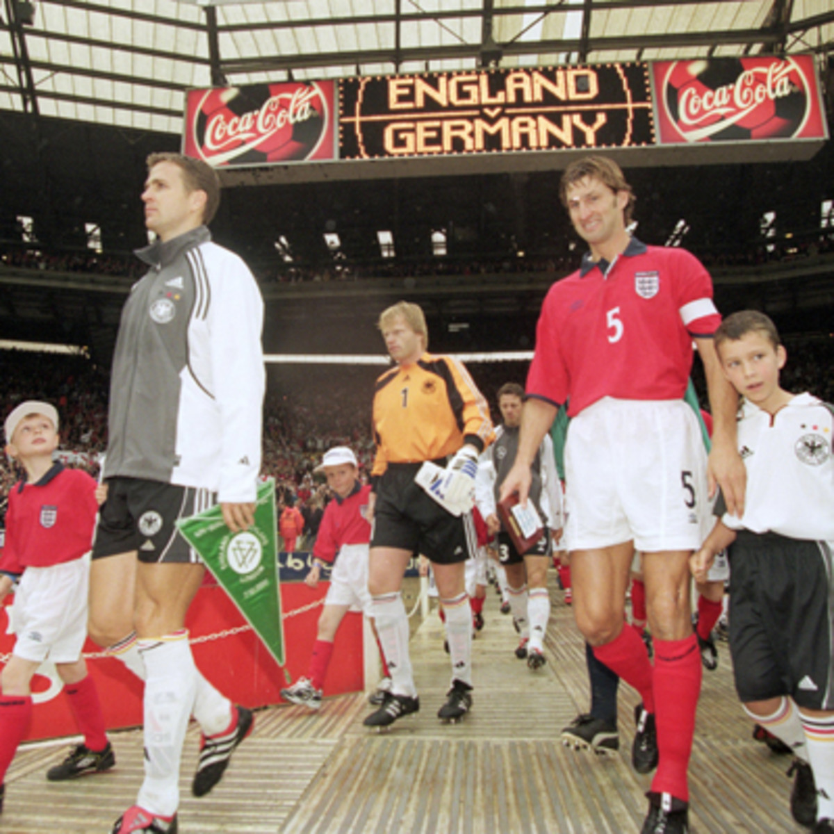 Oliver Bierhoff (gray jacket), Oliver Kahn (1) and Tony Adams (5) walking out onto the field on Oct. 7, 2000 in what was England's final match at the old Wembley Stadium. Germany won 1-0.