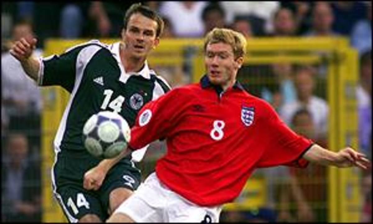 Germany's Dietmar Hamann (14) and England's Paul Scholes (8) battle for possession during a Euro 2000 match in Charleroi, Belgium. England won the match 1-0, but both nations exited the group stage in that tournament.