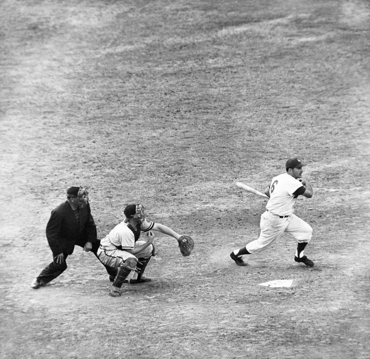 Furillo lining a hit during the 1959 playoff with the Milwaukee Braves. He was out of baseball a year later.