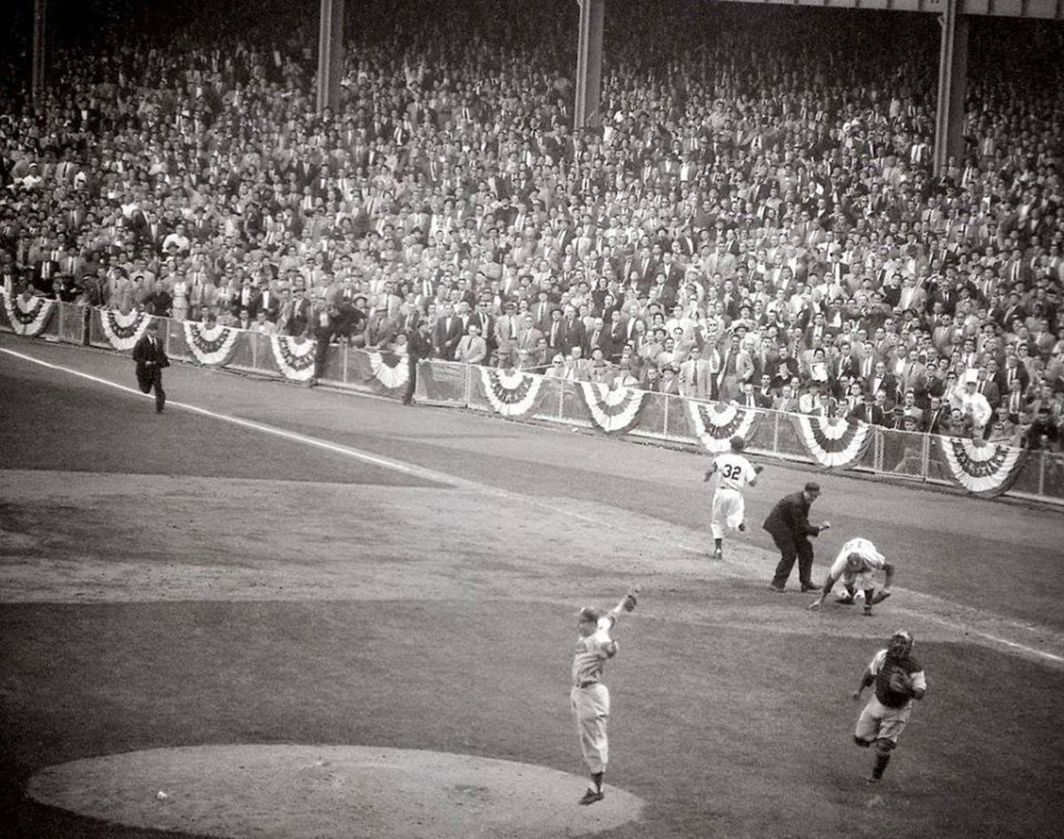 Finally!  Johnny Podres leaps for joy on October 4, 1955. The Dodgers win their first World Series in front of a shocked Yankee Stadium crowd.