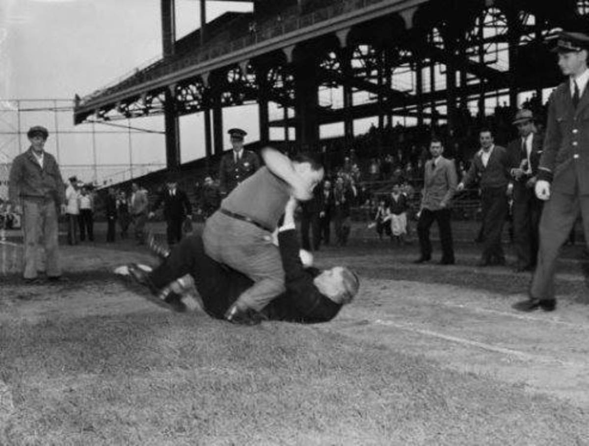 "1940: The ""Good Ol Days?"" Frank Gernano pummels umpire George Magerkurth after a tough loss by the Dodgers."