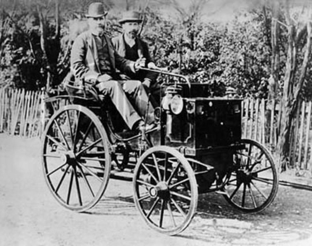 Two men ride in a Panhard-Levassor of 1895 vintage.