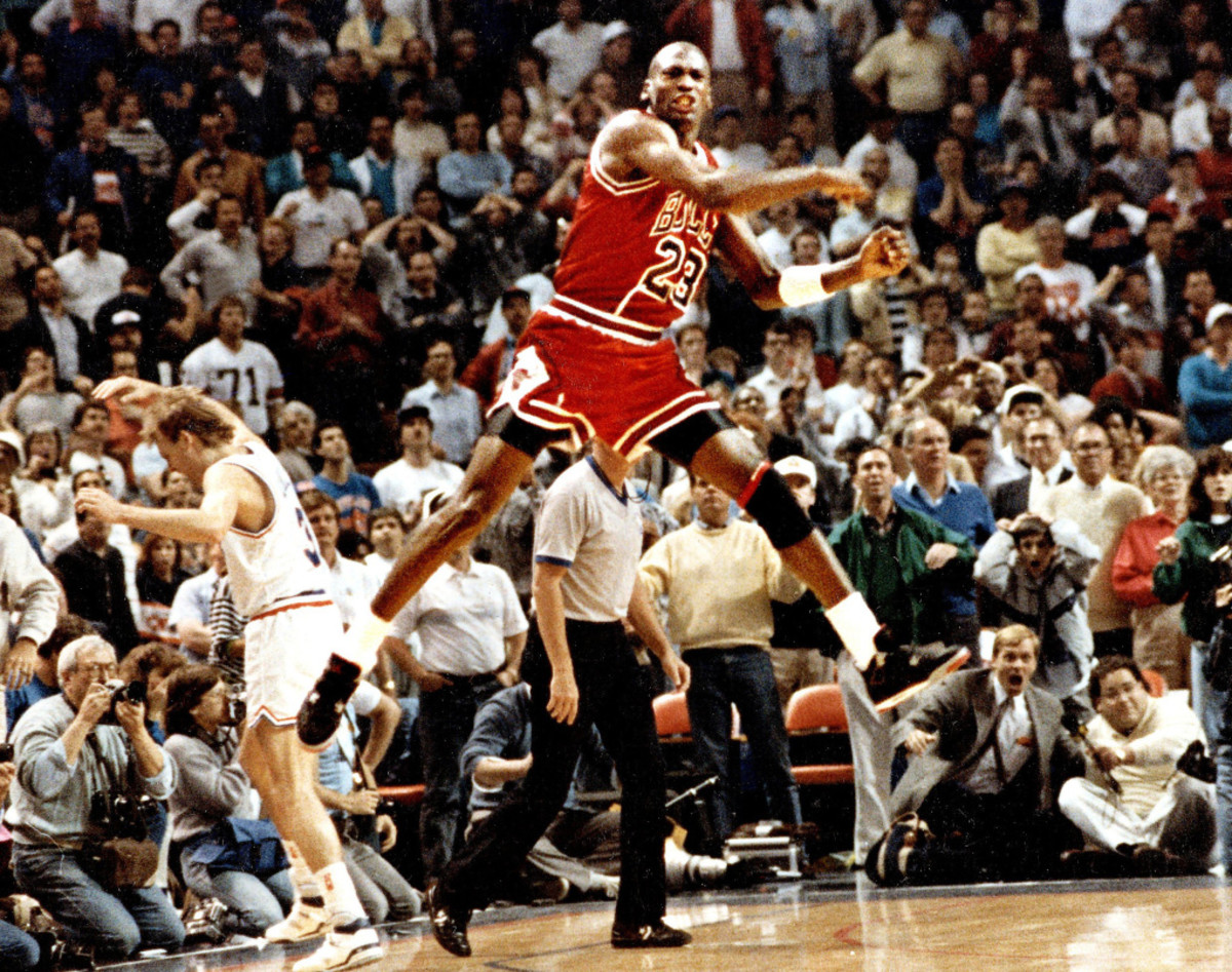 Michael Jordan celebrates after sinking the higher seeded Cleveland Cavaliers with a clutch mid-range shot.