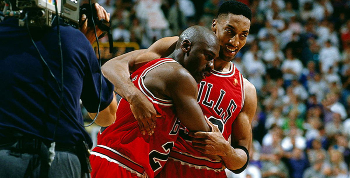 An exhausted Michael Jordan leans on Scottie Pippen after a 38-point outburst despite having flu-like symptoms.