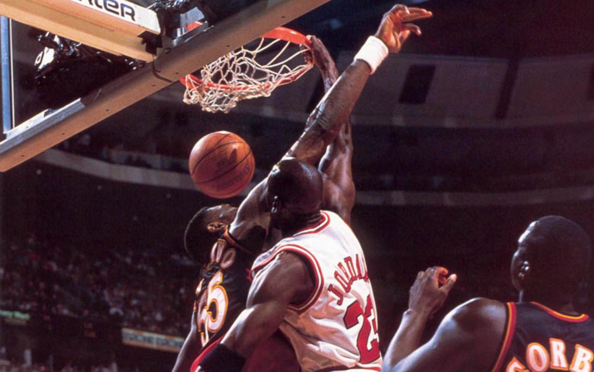 Michael Jordan finally scales Mount Mutombo.