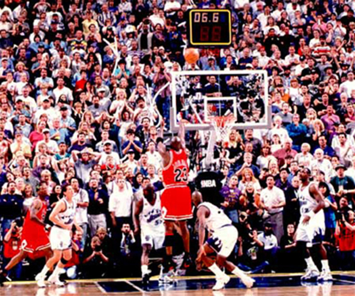 Michael Jordan has a fitting end to his career with the Chicago Bulls—winning the NBA Finals with a clutch jump shot.