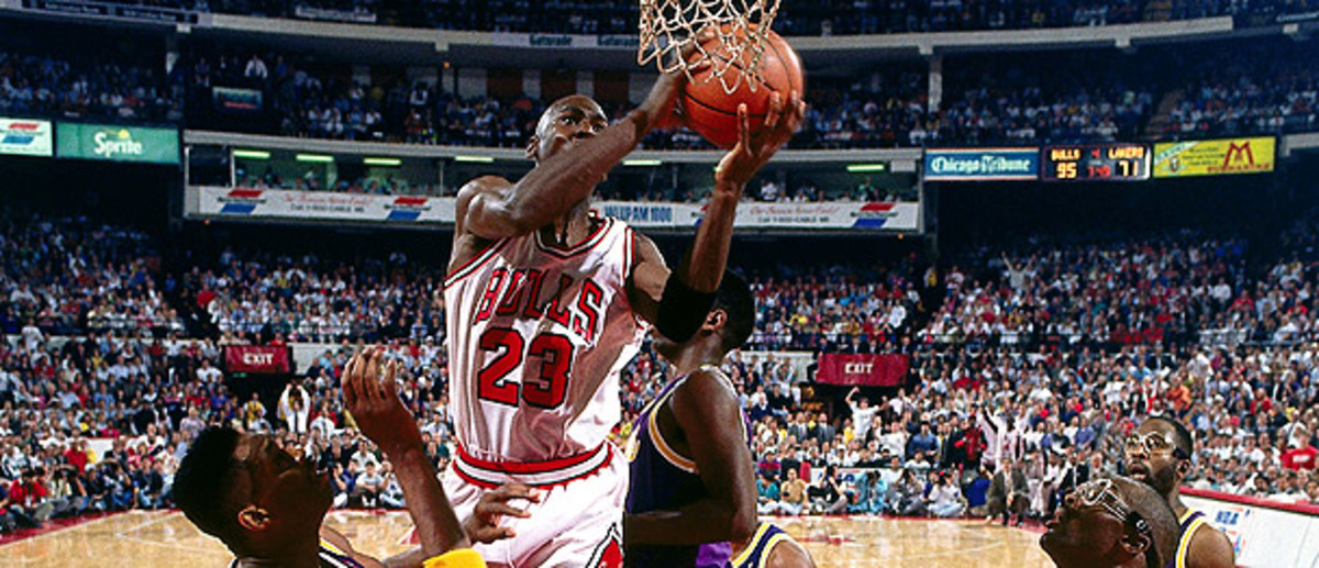 Michael Jordan defies gravity with a switch between the hands layup against the Los Angeles Lakers.