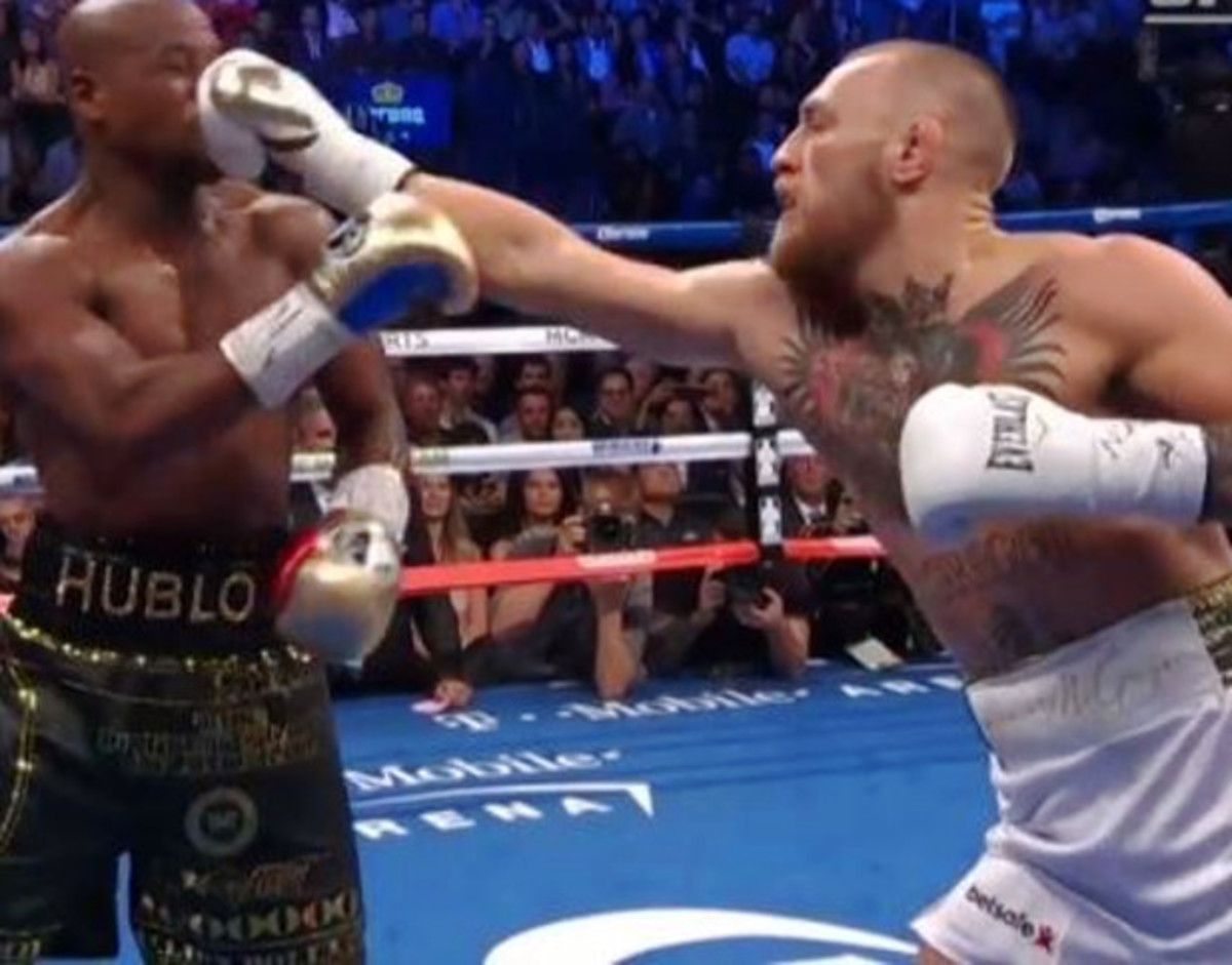McGregor stuns Mayweather with a long jab.