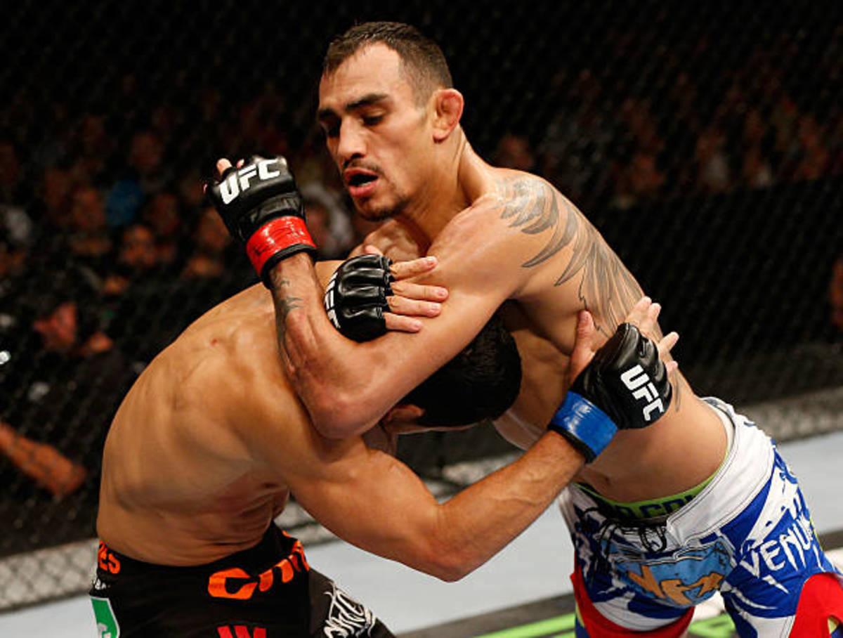 Tony Ferguson attempts to secure a D'arce choke against Danny Castillo.