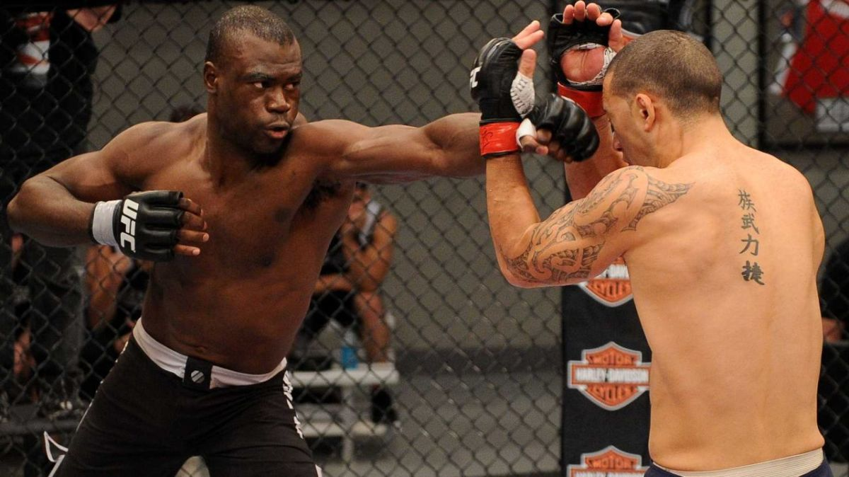Uriah Hall (left) throws a long jab.