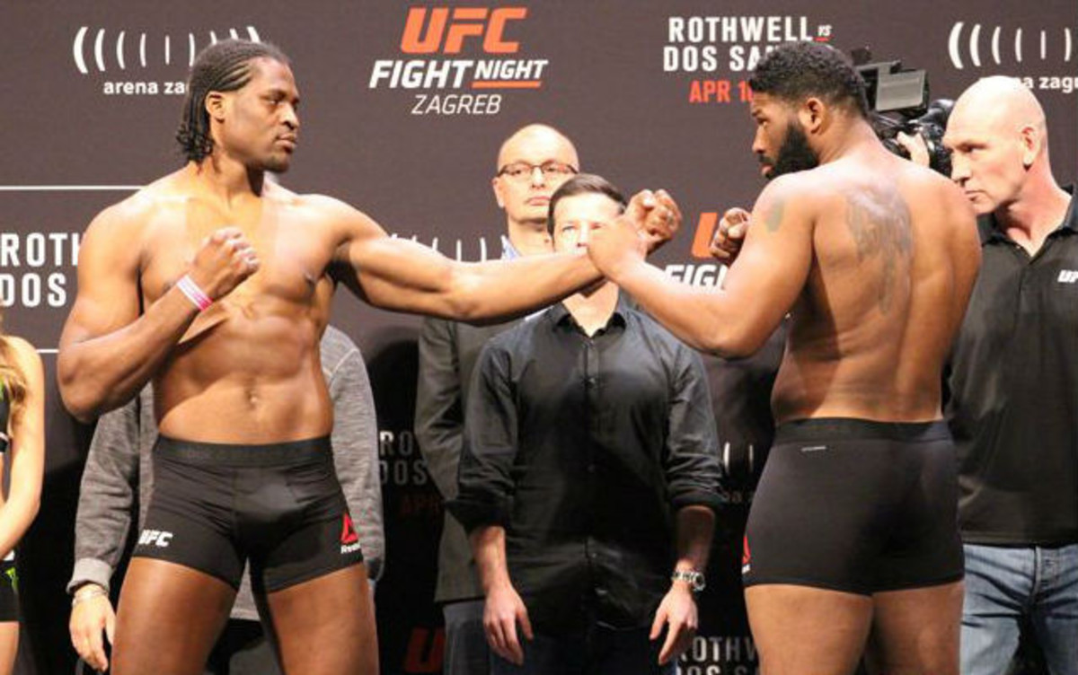 The long reach of Francis Ngannou (left) at full display.
