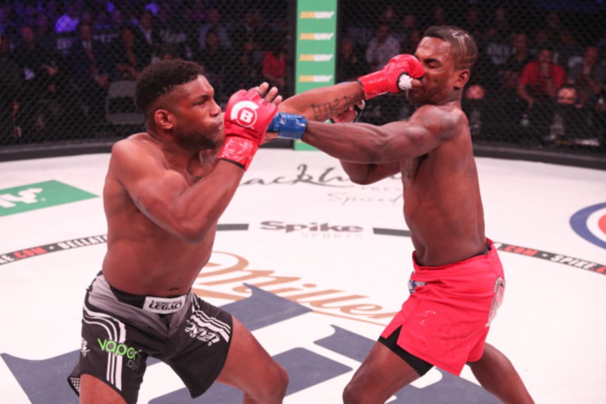 Paul Daley (left) stuns Lorenz Larkin with a long jab.