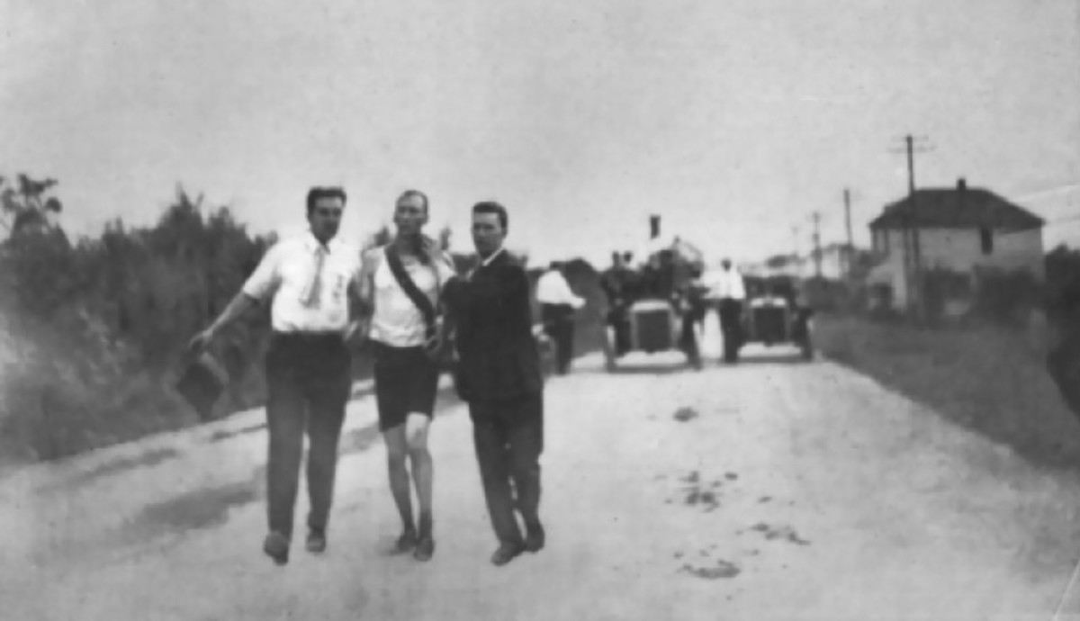 Hicks gets help from spectators during his winning marathon run.