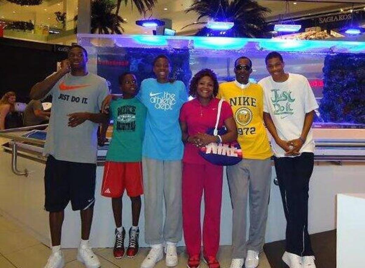 Giannis Antetokounmpo with his mum, late dad and brothers.