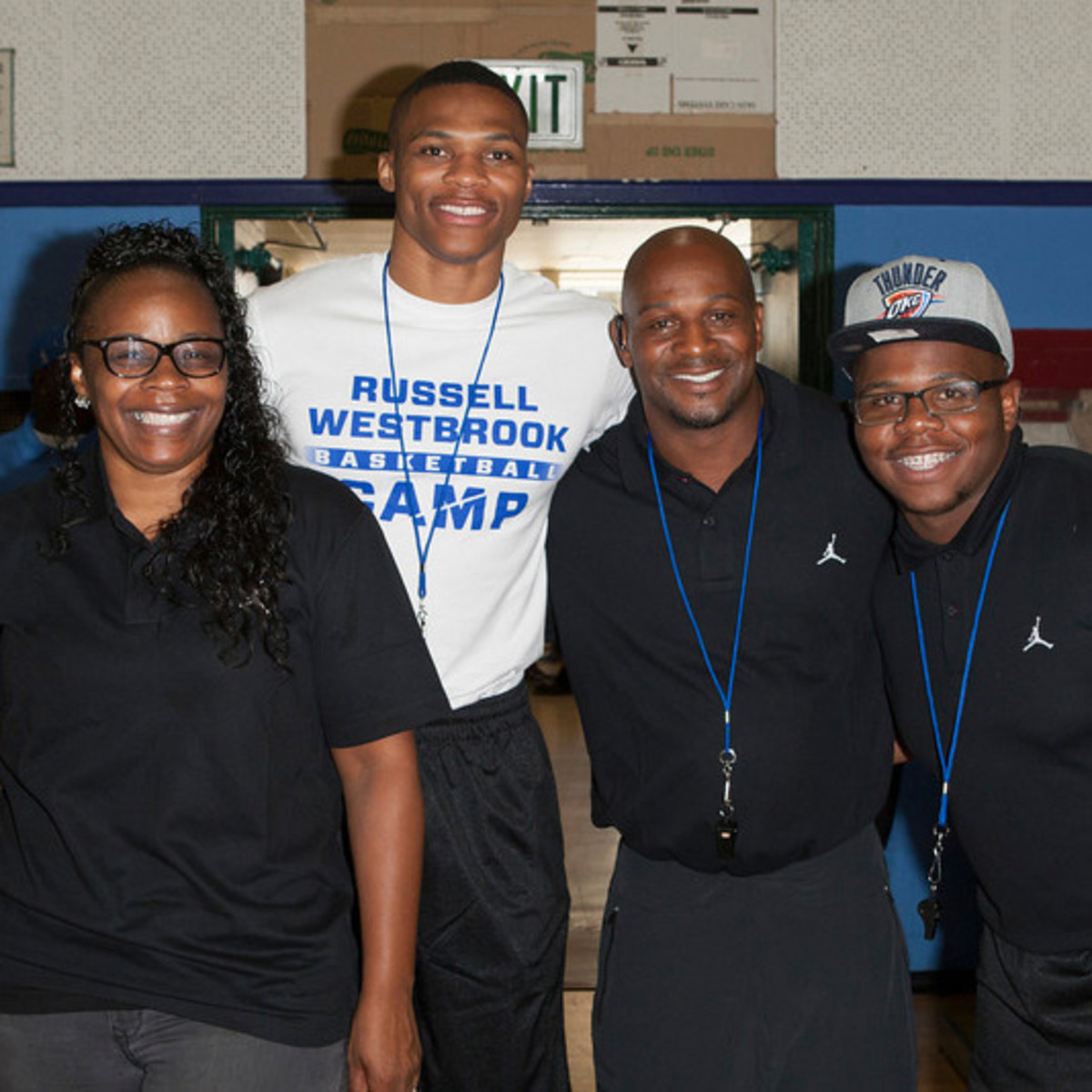 Russell Westbrook with his dad, mum, and brother.