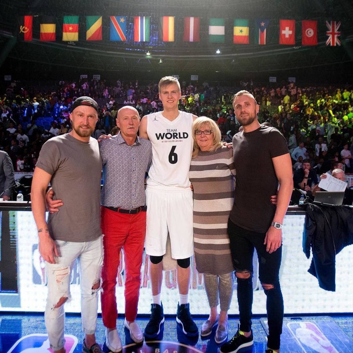 Kristaps Porzingis with his mum, dad, and two brothers.