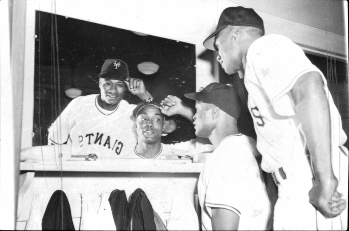 Monte Irvin and Hank in the Giants locker room.