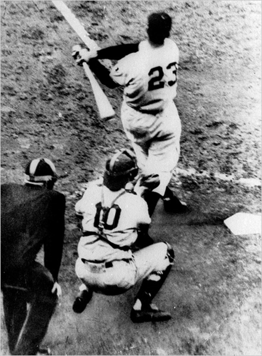 Bobby Thomson swings into history.  The Dodger catcher is Rube Walker, who was playing for the injured Roy Campanella.