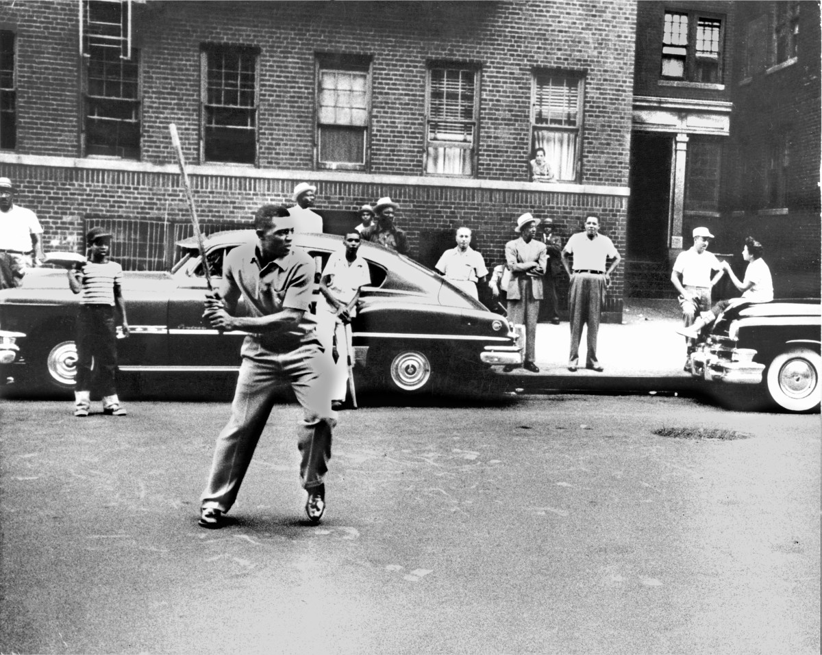 Willie playing stickball in Harlem, 1950s.  I believe this to be St. Nicholas Place, just up the street from the Polo Grounds.