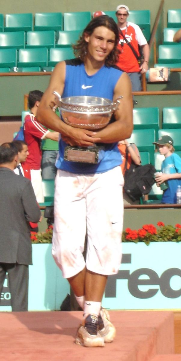 Rafael Nadal, seen here after winning the 2006 French Open tournament, has won the tournament a record nine times, including an Open Era record of five consecutive titles.